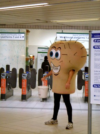 Man collecting money for a cancer charity dressed like a giant scrotum