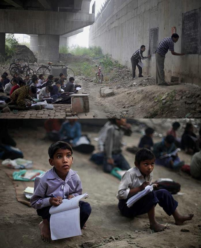 Indian children learning in a impromptu school under a bridge