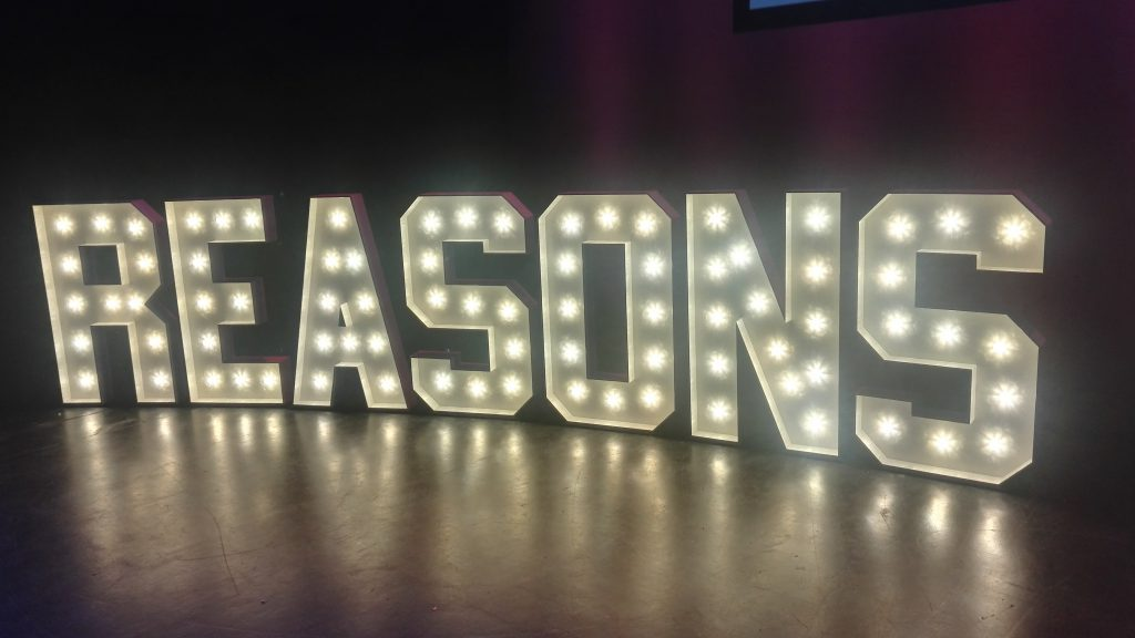 Reasons.to stage sign