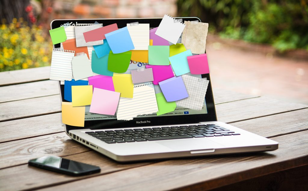 Macbook covered in sticky notes